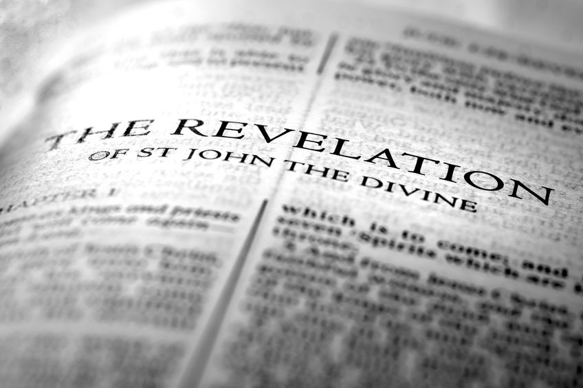 Bible open at Revelation, the descriptions of Jesus Christ