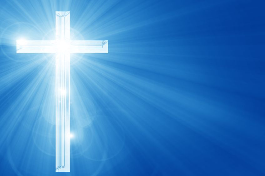 Bright shining cross on blue background