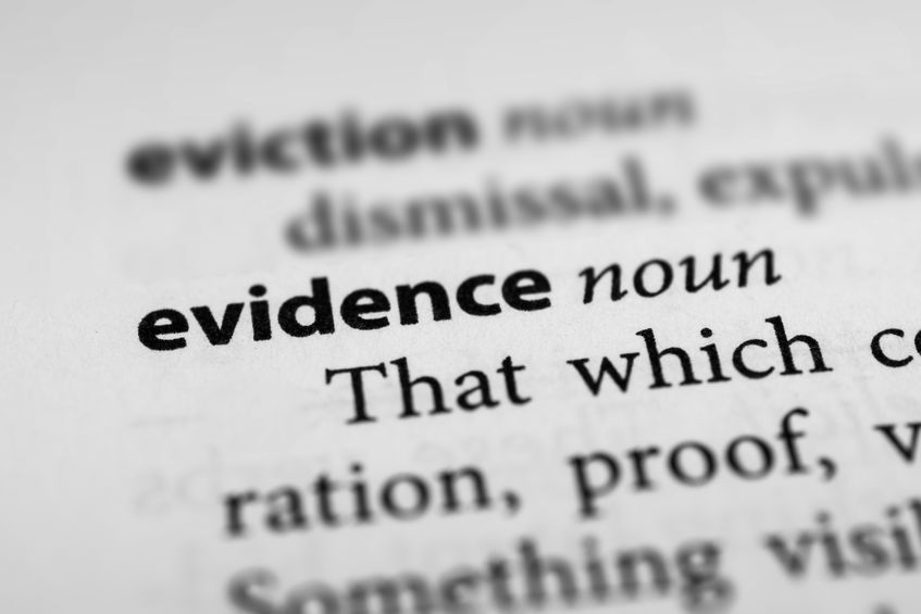 Close up of the word evidence looking to prove the Bible