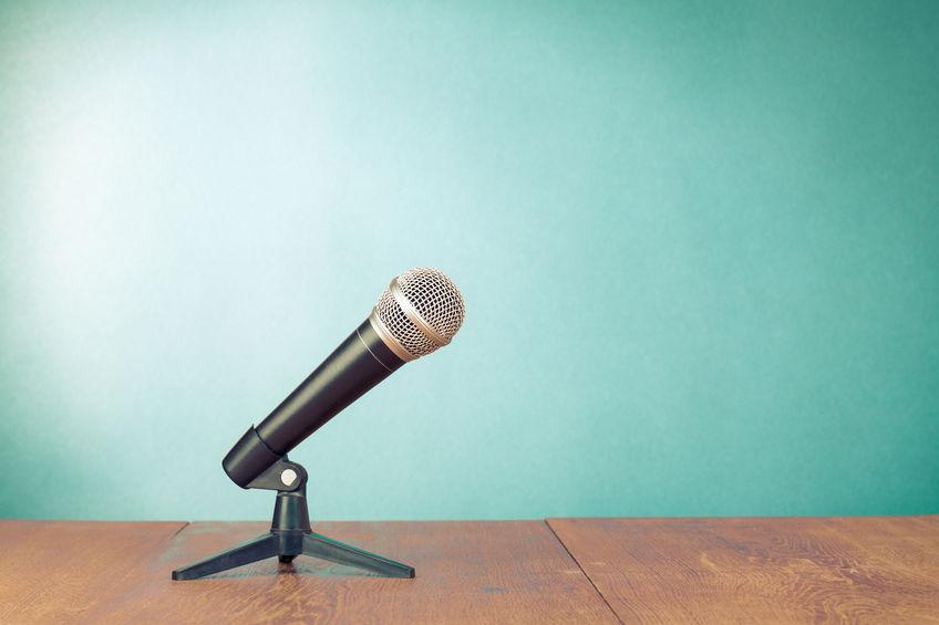 Interview microphone as Ben Shapiro interviews John MacArthur