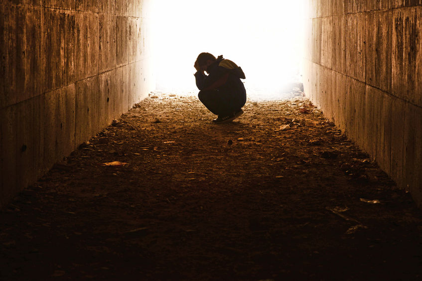 Person along is a dark tunnel wonder why does God allow suffering